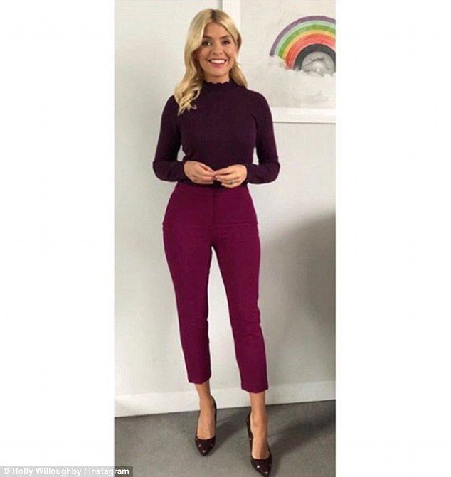 Amazing: Holly Willoughby, 36, wowed as she showed off her slimmed down figure in a maroon-coloured top and purple ankle-grazing trousers on Instagram on Wednesday