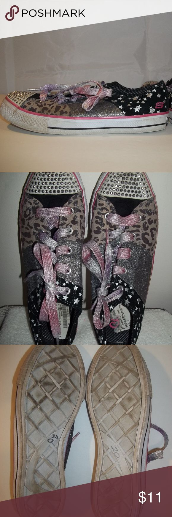 Skechers Shoes Stars Sparkle Leopard Size 8.5 Women's Sneakers Shoes  Brand: Skechers  Size: 8.5  Color: Multi color  Features: Pink/purple/silver laces   Stars, sparkle, leopard pattern  Faux studs on toe area  Material: Textile upper  Measurements (Outside bottom)  Top to bottom: 10.5 inches  Side to side (widest spot): 3.5 inches  Condition: Pre-owned in great condition.  Show some wear with plenty of wear left.  There is 20 marked on the bottom of each shoe. Skechers Shoes Sneakers