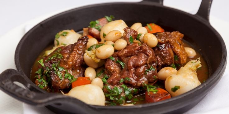 Richard Corrigan's lamb navarin recipe is a take on the classic French stew and is full of rustic flavour from braised lamb, garlic, anchovy and turnip.