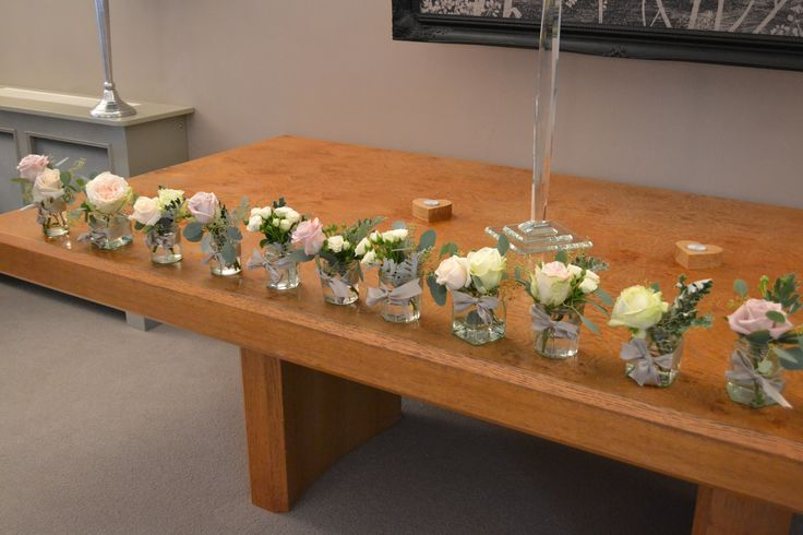 Rustic Jam Jars of flowers at Russets Country House hotel by Eden Blooms Florist. Placed in registrar's table