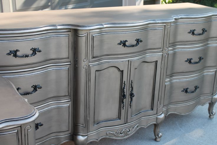 """The Magic Brush-Warm Silver - Prep by cleaning & sanding. Have paint store tint a latex primer appropriate for furniture to a color similar to Sherwin Williams """"Latte"""".  Roll that on. Paint the furniture with Modern Masters Warm Silver.  It's a silver….but like the name implies, it's warm.  So sometimes it looks champagne almost. We use the lowest nap roller we can find in the 4"""" size.  Try not to overwork the rolling or you will see lap lines because it's a metallic."""