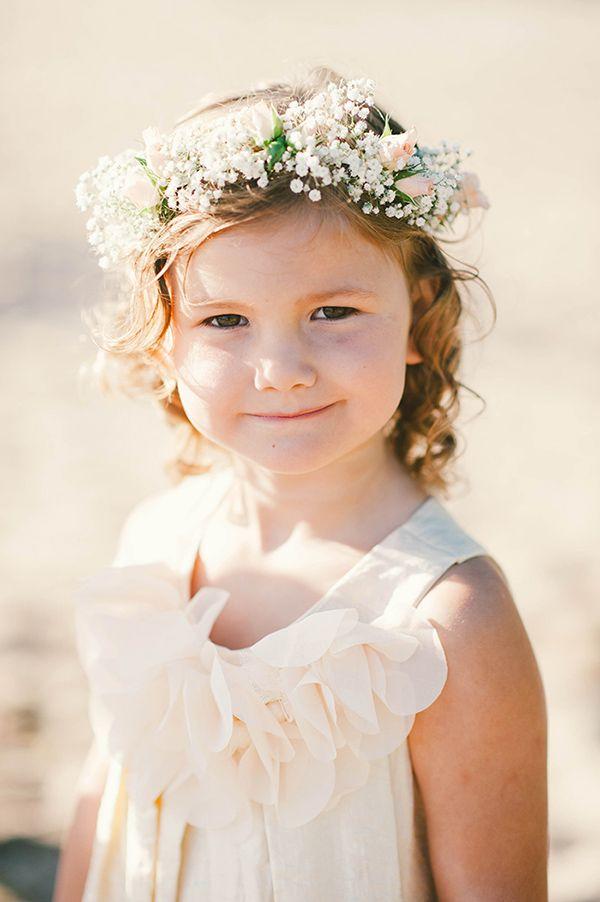 cream flower girl dress with peach rose and baby's breath floral crown #flowergirl #floralcrown #beachwedding http://www.weddingchicks.com/2013/11/06/sunset-wedding/