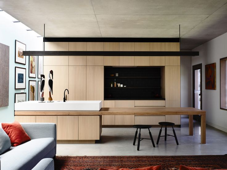 {Going down under for our Friday Feature today with Rob Kennon Architects. In this project, I like all the clean-lined millwork, and surprising use of colour.}  Anchored to a steep site near the Yarra River, In-situ House has a strong respect for materials. Atypical to the surrounding neighbourhood, it returns craftsmanship and natural materials to the landscape, while still presenting a home of significant scale. It also challenges the typical planning of a Toorak family home.via