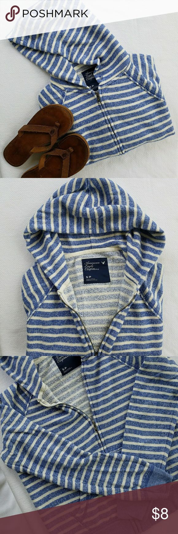 American Eagle Striped Zip Up Hoodie Size S Blue and White ultra soft striped hoodie. Only when taking photos did I notice a few small stains near the wrist on one of the arms that I tried to show in the last photo. Barely noticeable. Great hoodie for summer nights and a wonderful combination of heathered blue and white. Such a comfy hoodie that pairs well with jeans or khakis. American Eagle Outfitters Tops Sweatshirts & Hoodies