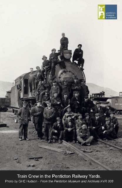 Train Crew at the Penticton Railway yards, posing in front of a steam engine. Photo from the Penticton Museum and Archives.