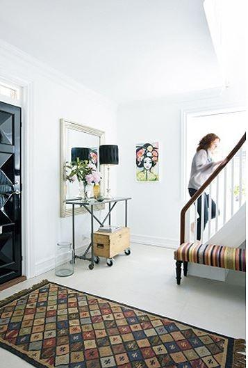 scandinavian white backdrop to colourful accessories in a Danish designer's home