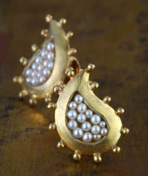 Pearl-decorated paisley ear studs at Rs.18,400 online in India.