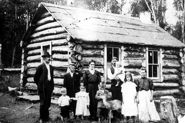 Haveri family in front of their log home, Finland, MN.  Photograph Collection, Postcard ca. 1900