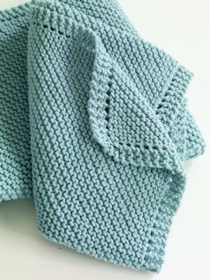 Diagonal Comfort Blanket - 850 yds worsted weight cotton. Garter stitch - circular needle used for amount of stitches. Great for baby showers.