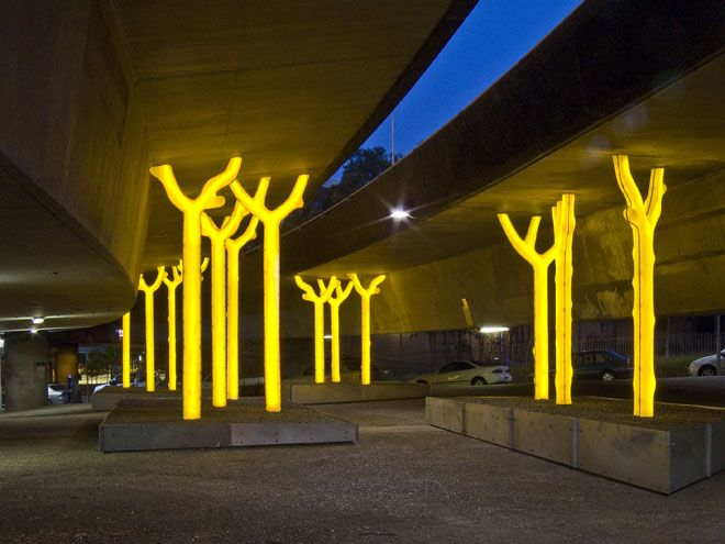 Aspire - Under The Freeway  This community-initiated artwork consists of a forest of trees rising up to support the vast freeway overhead.