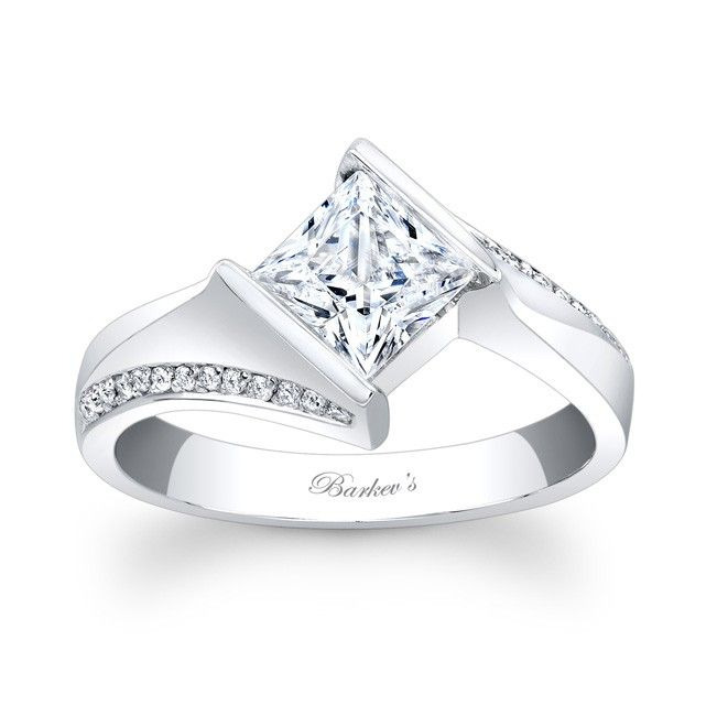Trendy The channel set princess cut diamond center is captured in the split twisted ridges while pave set diamonds accent the shoulders edge a bright polished
