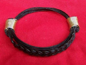 JEAR7 Bracelet braided hair between knots -gold wire. Fits any size. Price $190 incl. ship & insurance
