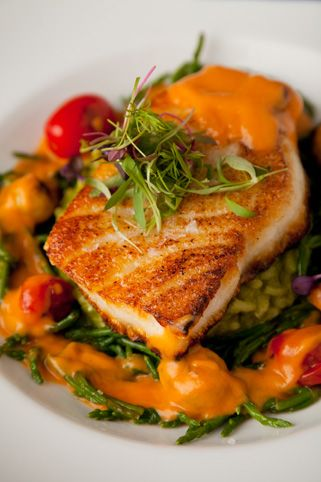 Chilean seabass with lemon basil risotto, heirloom cherry tomatoes, sea beans and tomato emulsion