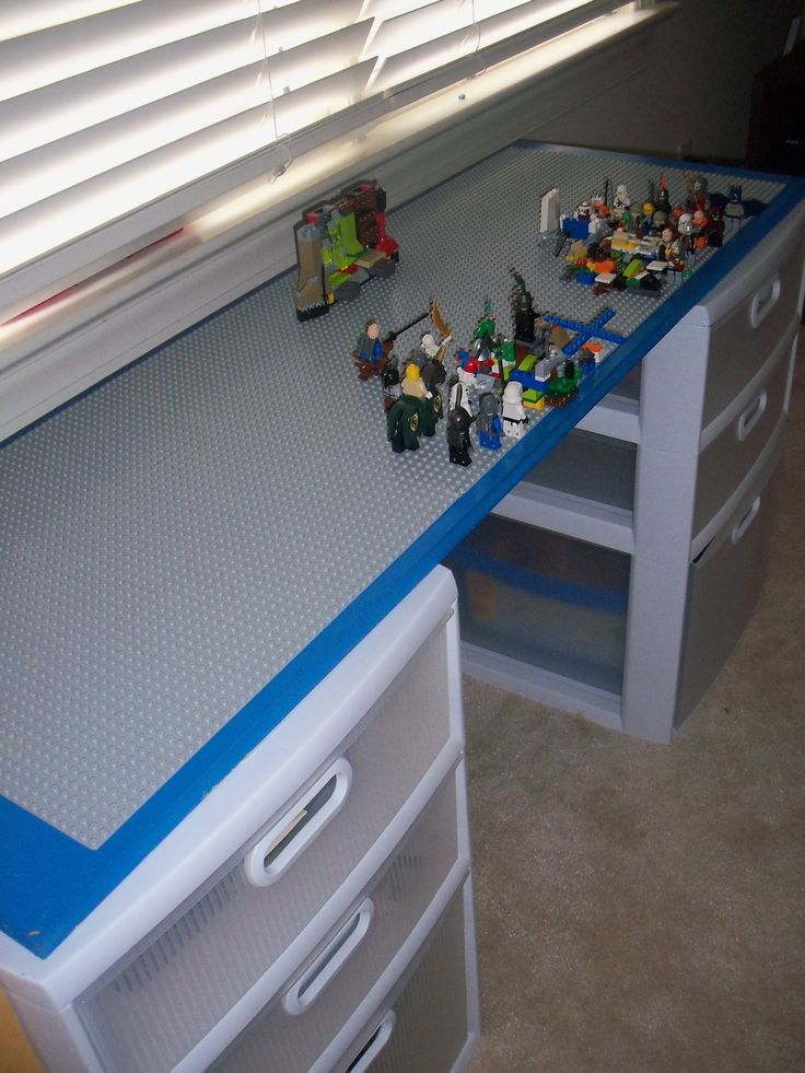 Lego Table to help contain the Lego sprawl! I painted a pre-finished shelf and then topped it with three 15 inch Lego building plates. The top is attached to two sets of storage drawers that fit more organizers for the tiny parts, all of the instructions, big bins of loose Legos, and the boxes of the bigger sets. Plus it is a good play space for creations that have been completed.