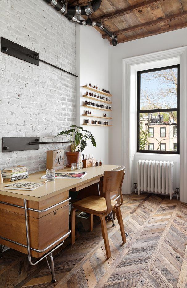 Kem Weber Vintage Desk | Chevron Patterned Hardwood Floors | White Brick Wall