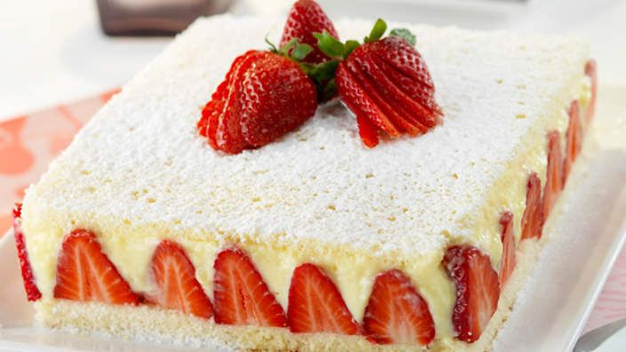 Vanilla cake | With heavenly layers of sponge, vanilla custard and strawberries, this is no ordinary vanilla cake. It's the perfect dessert for entertaining, not just because it looks and tastes stunning, but also because all the hard work is done well before the guests arrive.