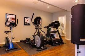bright basement basementupgrades  home gym flooring