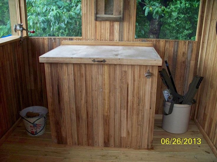 Use wood and counter tops to hide a chest freezer in kitchen and use the counter space for food prep.