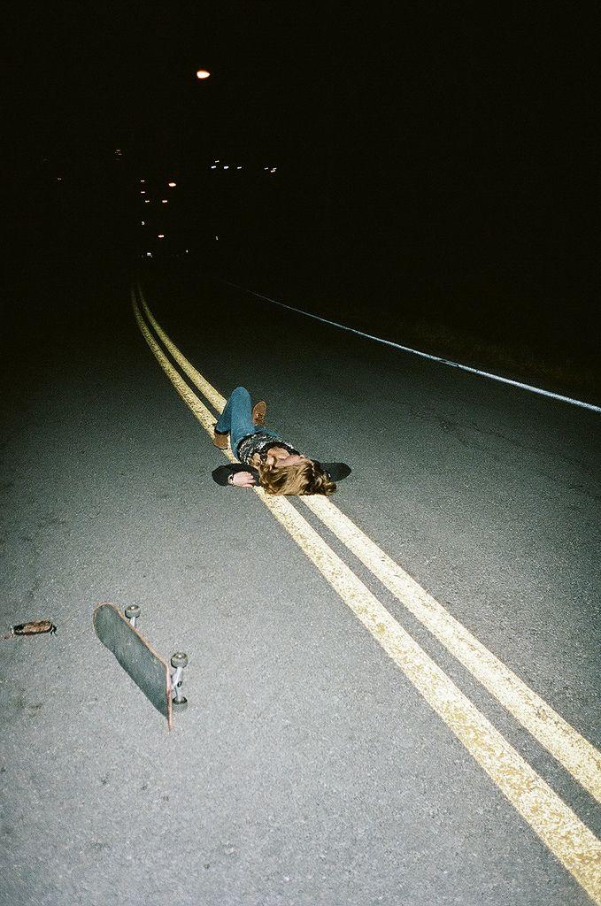 Lying in the street, skateboard, indie, rebel, teenager.