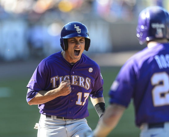 LSU's Jared Foster scores on a double by LSU's Tyler Moore to tie the game at 2-2 in the top of the ninth - LSU had been down to their last strike - during the SEC Baseball Tournament Game 13, featuring Alabama and LSU, Friday, May 24, 2013, at the Hoover Met in Hoover, Ala.