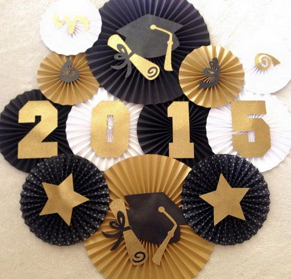 Fan Backdrop Graduation Decor. It's very necessary to create a beautiful backdrop for your graduation party. Display fans in gold, black and white to match the graduation theme. All the diploma and stars add up for graduation flavor to this backdrop.