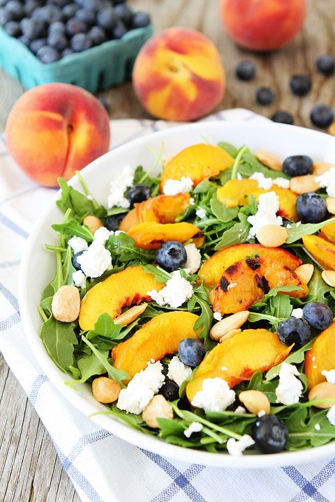 Grilled Peach, Blueberry, and Goat Cheese Arugula Salad Recipe on twopeasandtheirpod.com Love this simple and beautiful summer salad! #salad