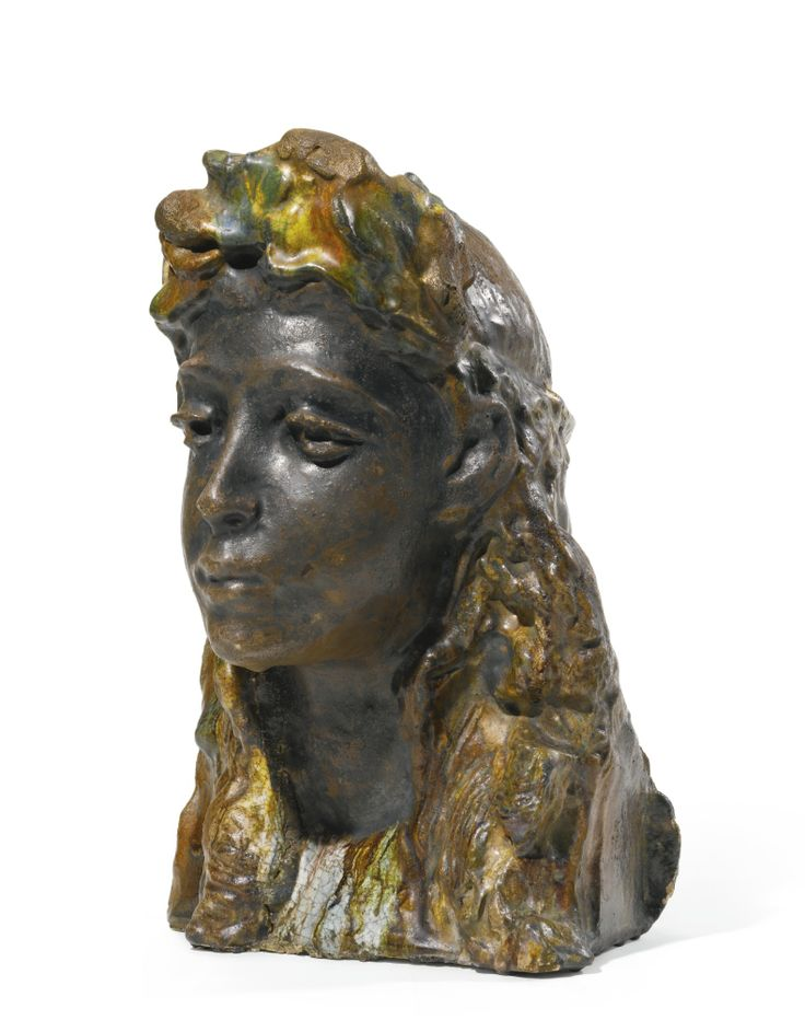 MIKHAIL  VRUBEL (1856-1910)  - GIRL WITH A WREATH, c. 1898,  earthenware with coloured glazes, H: 33cm, 13in.