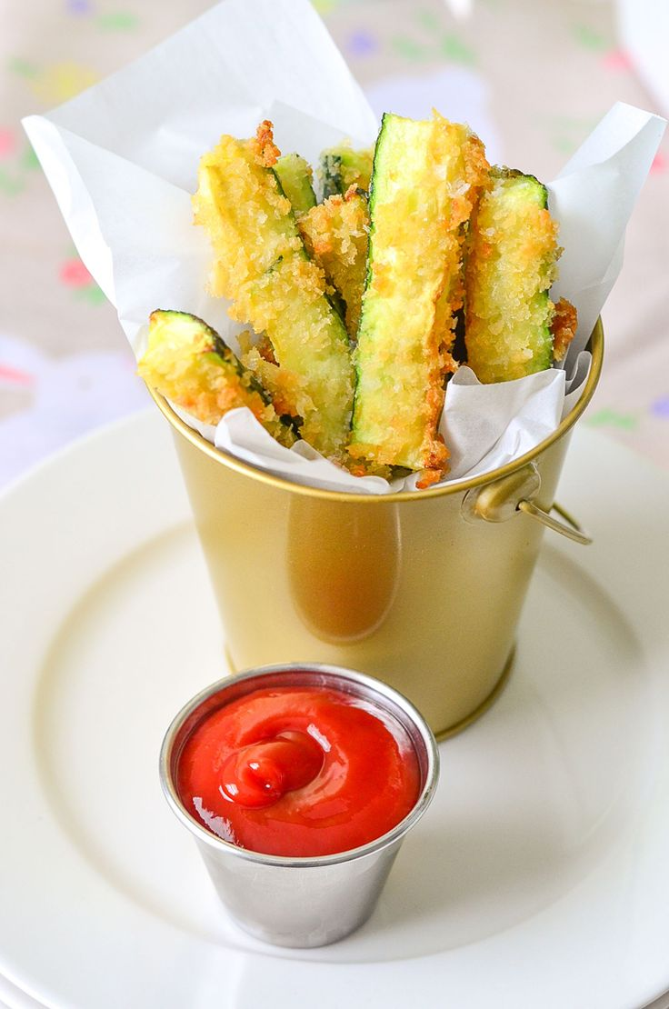 Quick and Easy Zucchini Fries Recipe - Yum! These are baked and then quickly pan-fried in coconut oil to make them extra crispy! Gonna try these this summer.