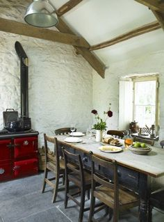 Rural dinning room.  Pared de piedra encalada