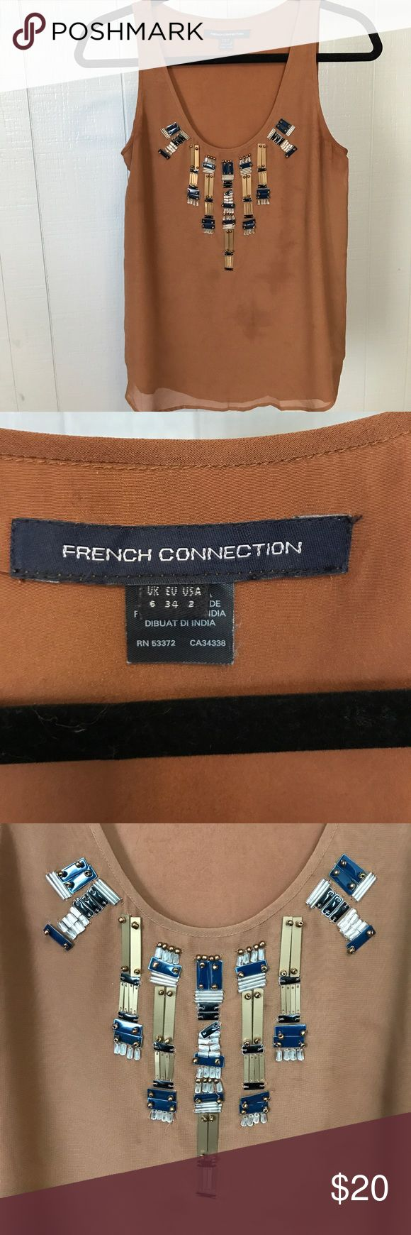 French Connection, brown tank with beaded detail. French Connection, camel color tank with scoop neck and beaded detail in front. Slight discoloration on front and back, but still in great condition. Perfect with jeans or a pencil skirt! French Connection Tops Tank Tops