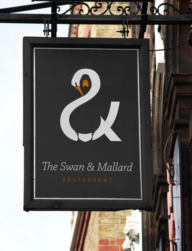 "In this design for a restaurant called ""The Swan & Mallard,"" John Randall has creatively managed to fit a swan, a mallard duck, and an ampersand all into one logo"