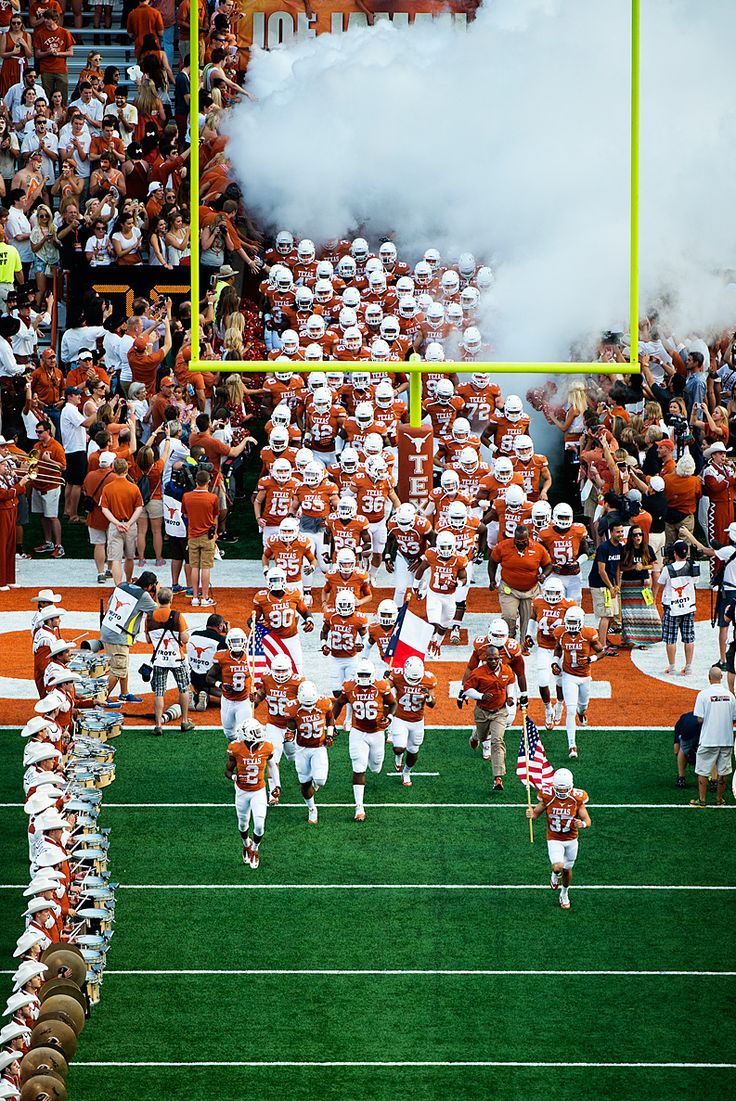 The Texas Football team enters the DKR Texas Memorial Stadium.