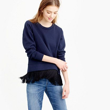 "We paired the classic sweatshirt silhouette with of-the-moment fringe for a surprising new take on the dressy-casual top. <ul><li>Slightly loose fit.</li><li>Body length: 21"".</li><li>Cotton/poly.</li><li>Bracelet sleeves.</li><li>Dry clean.</li><li>Import.</li></ul>"