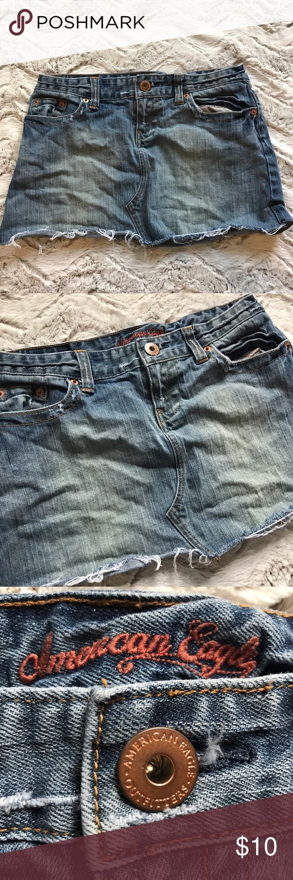 """American eagle short distressed mini Jean skirt 4 Distressed Jean skirt mini size 4✨ waist flat is approximately 14.5"""" and length approximately 11.5"""". Pockets on back and front ✨ American Eagle Outfitters Skirts Mini"""