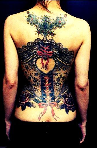 Exclusive tattoo for women. Super-complex and colorful corset inked on a whole girl's back.