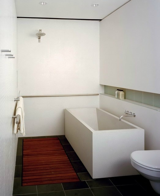 Love this style shower/bath combo. Very modern looking. Doesn't take much space either.