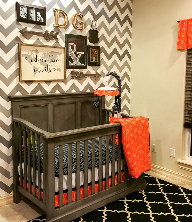 Our baby boys nursery. Orange, grey, Navy and white.