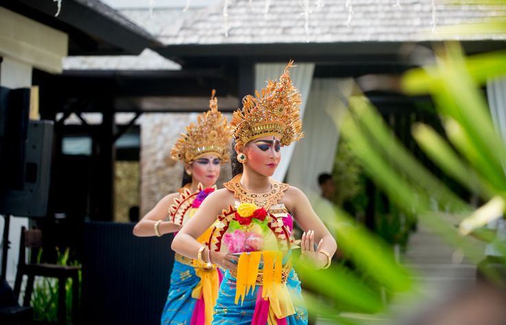 Traditional Balinese dancers perform at a wedding in Bali, Indonesia.  Photo by Justin Mott | Mott Visuals Weddings  #MottVisualsWeddings #MottVisuals #JustinMott #Balidestinationweddingphotographer #Balidestinationweddingphotography #IndonesiaWedding #traditionaldance #IndonesianCulture