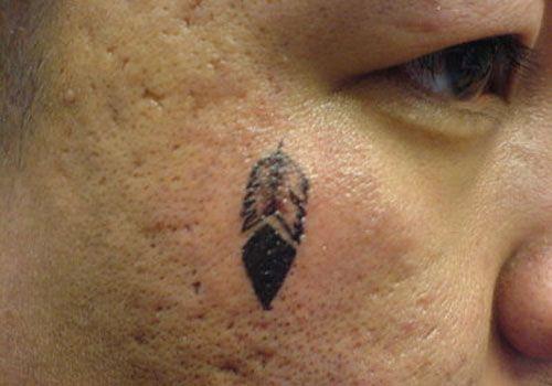 ivy-face ~ http://heledis.com/beautiful-face-tattoo-designs/