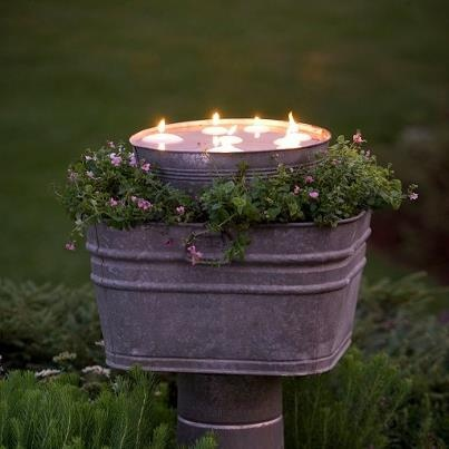 Great idea...floating candles by night and trailing lobela by day!