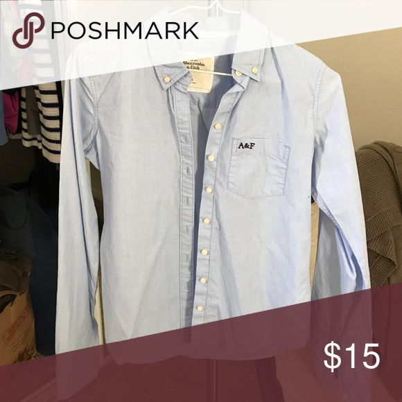 Abercrombie &a Fitch Blue Button Up Shirt Worn once! White Abercrombie button up shirt with navy logo on chest. Excellent condition! No stains rips or holes! Abercrombie & Fitch Tops Button Down Shirts