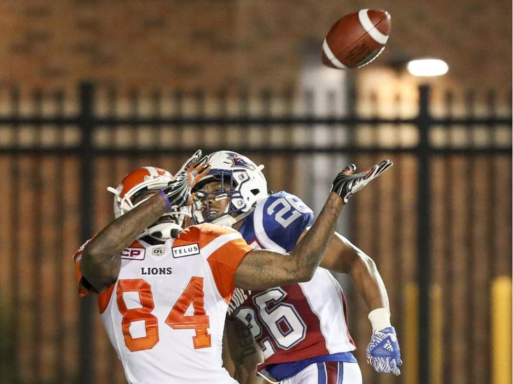 Week 3 - July 6 2017 - BC.23 - MTL.16 - Montreal Alouettes defensive back Tyree Hollins interferes with British Columbia Lions receiver Emmanuel Arceneaux in the end zone during second half of Canadian Football League game in Montreal Thursday July 6, 2017. Hollins was penalized on the play and B.C. subsequently scored the game-winning touchdown.  JOHN MAHONEY/MONTREAL GAZETTE