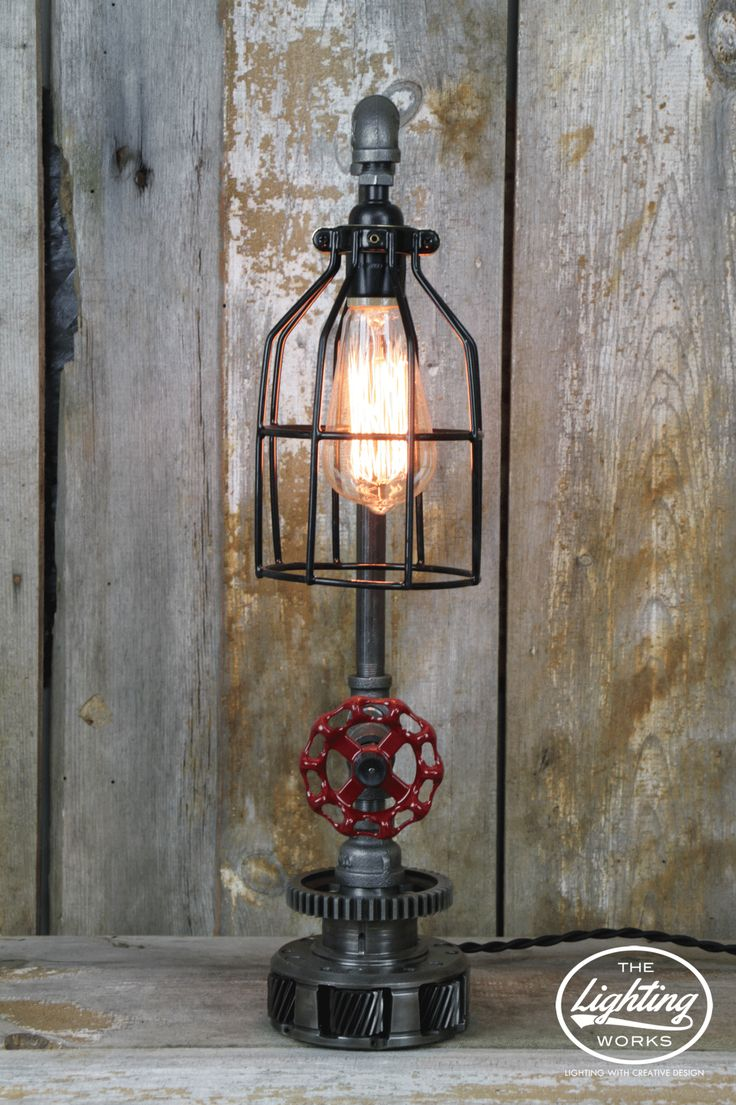 Steampunk Industrial Machine Age Lamp Crafted from a variety of electrical and plumbing components, this incredible industrial table lamp offers a distinct style that is reminiscent of decades past! A