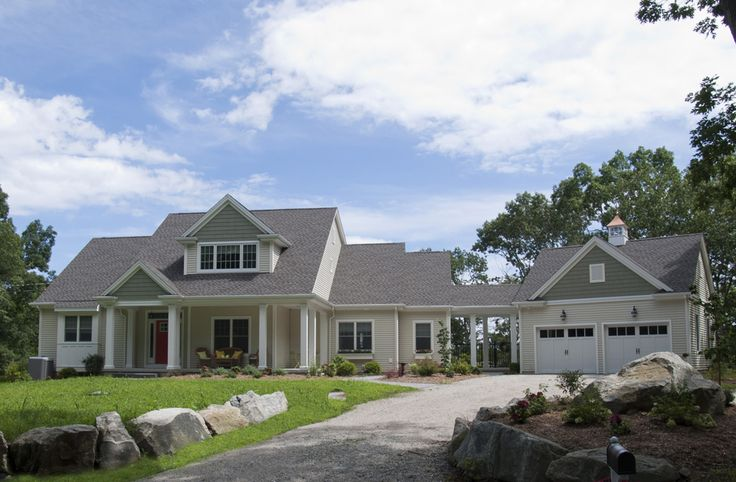 Custom #craftsman style expanded cape with covered breezeway, accent siding, #reddoor and 2-car garage w/ cupola.