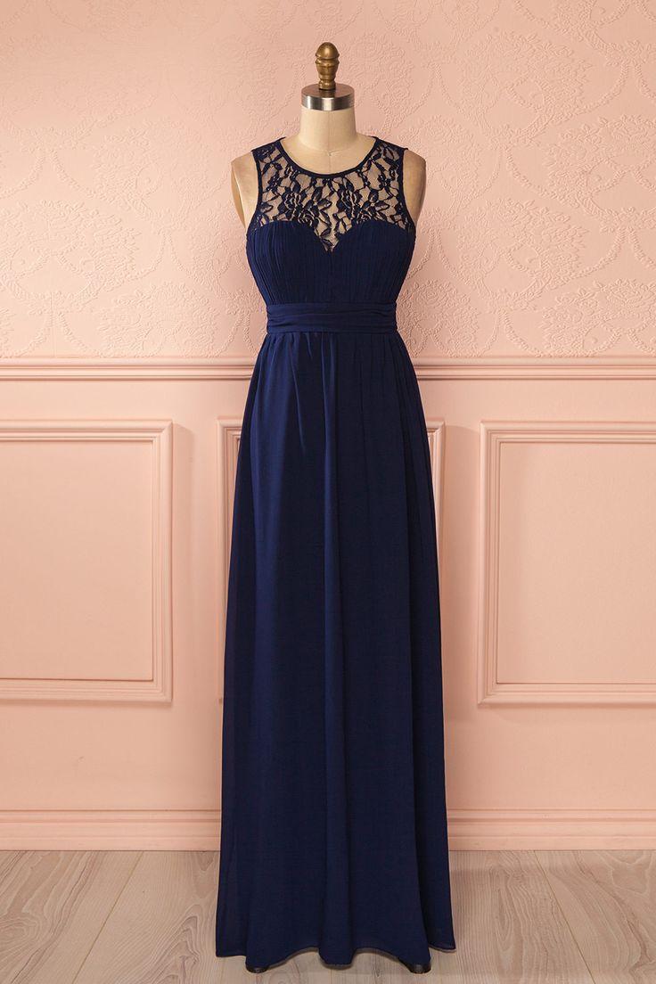 Elle s'avança fièrement vers la grande salle de bal dont elle avait toujours rêvée.  She walked proudly towards the grand ballroom she had always dreamed of. Navy blue lace neckline maxi dress www.1861.ca