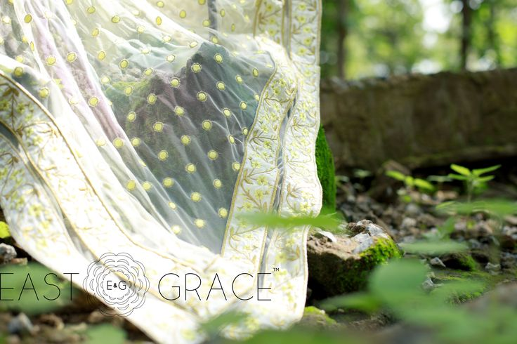 Featuring a light cream net saree with yellow Primrose floral patch border and gold-bordered yellow polka pattern embroidered all along the pallu. PRICE: INR 16,740.24; USD 253.64 To buy click here: https://www.eastandgrace.com/products/primrose For help reach us at care@eastandgrace.com. With love www.eastandgrace.com