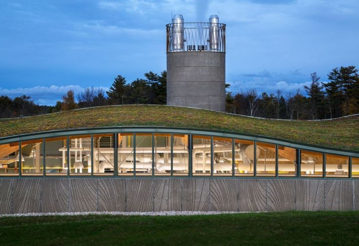 Hotchkiss Biomass Power Plant / Centerbrook Architects and Planners. Sited at the bottom of a sloping landscape, between woods and wetlands on one side and a golf course on the other, the building presents a low and undulating profile. This furnace dwelling was designed to do double duty as a living classroom.