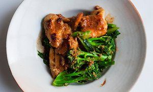 chicken and served with sizzling greens.