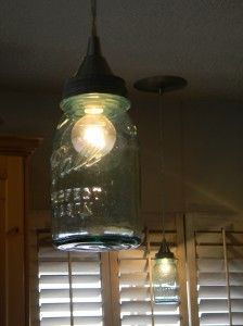 Kitchen Ball Jar lights...the Bob Evans in town has these over their bar and the bottoms are cut out so they are open.  I really like the look!