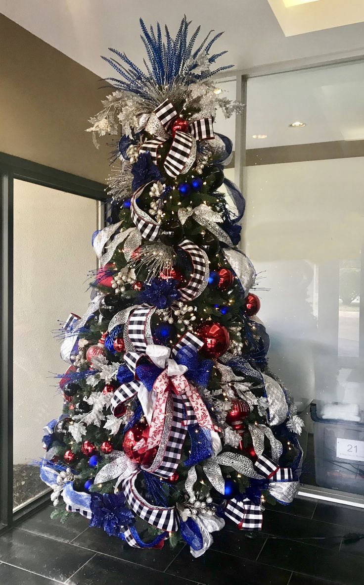 Red, silver, white and blue Christmas tree. Designed by Arcadia Floral and  Home